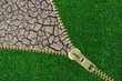 Global Warming. Zipper with cracked earth and grass