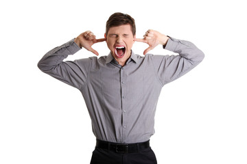 Angry man plugging his ears and shouting