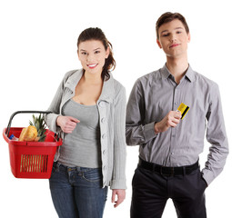Shopping young couple with grocery items