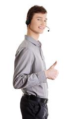 Customer service representative gesturing OK