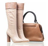 Fototapety Women high-heeled boots and leather bag over white