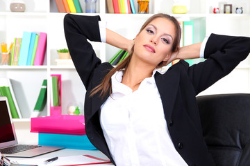 Business woman relaxing in office