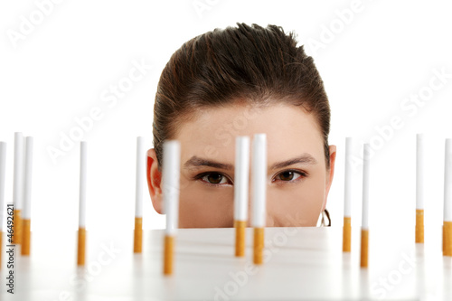 Young woman looking on cigarettes