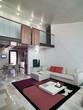 soggiorno moderno con soppalco