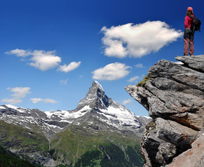 girl looking at the Mount Matterhorn in the Swiss Alps