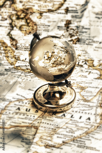 Old fashioned earth glass globe on the vintage map