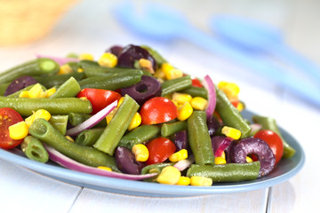 Green bean salad with tomato, corn, olive and onion