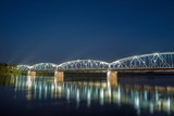 Bridge on Wisla river at night in Torun, Poland.