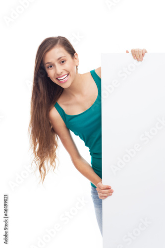 Young woman with blank poster