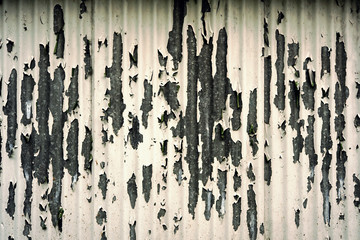 Grungy peeling painted metal background