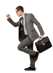 Man in a business suit with suitcase isolated