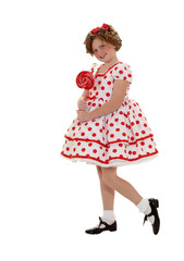 Standing in a Polka Dot Dreass Holding a Lollipop