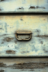 Old grunge peeling wooden door