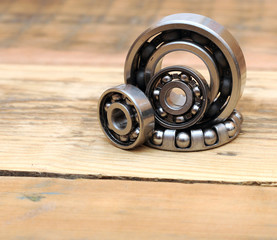 steel ball bearings on wooden background