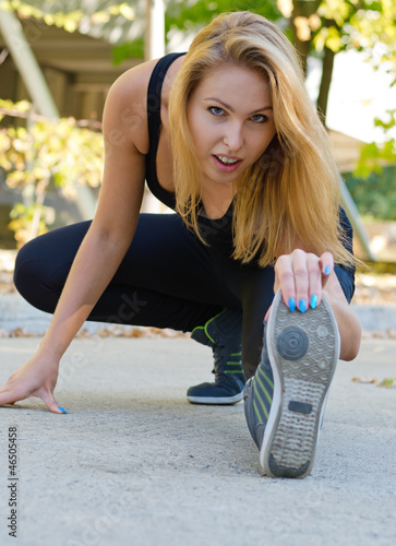 Attractive blonde girl working out