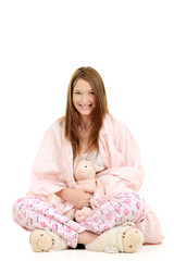 Girl wrapped in pink blanket with toy lamb