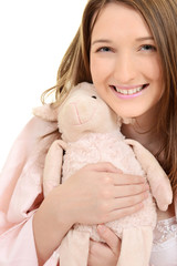 Teen girl hugging toy lamb