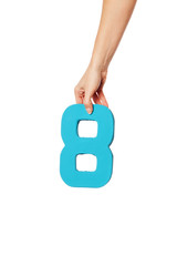 hand holding up the number eight from the top