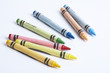 Colourful crayons against white background