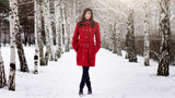 Beautiful elegant woman in red coat