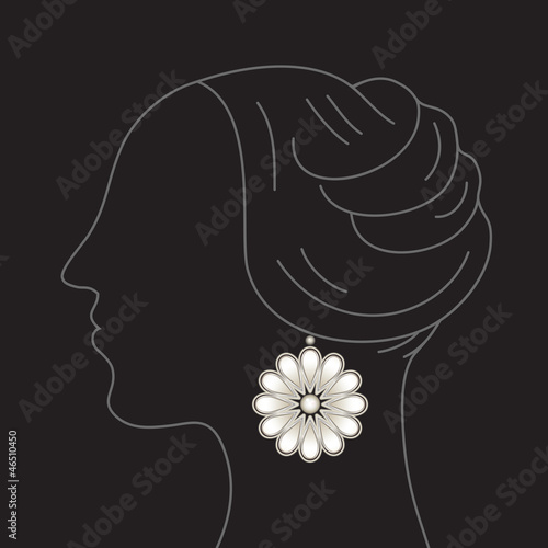 Woman profile with floral earring pendant on black