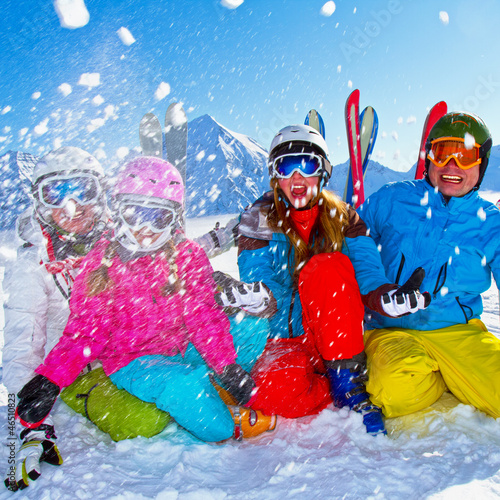 Ski, snow, sun and winter fun - happy family ski team - 46510823
