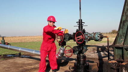 Man Working on Oil Field Equipment