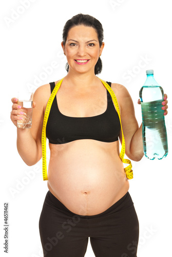 Happy pregnant woman with water