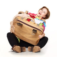 Pretty woman packs her overcrowded bag for holiday