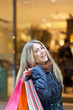 Blond woman shopping