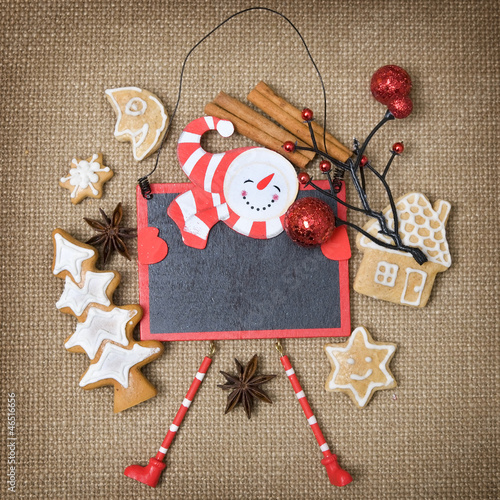 Snowman board with gingerbread and spice