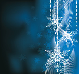Christmas background in blue colors with snowflakes.