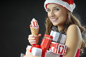 Christmas funny  girl with ice cream  covered  gifts wearing Sa