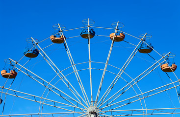 Ferris wheel over blue sky background