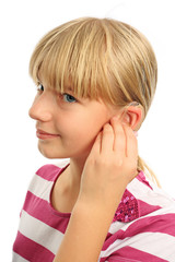 Blonde girl and her hearing aid