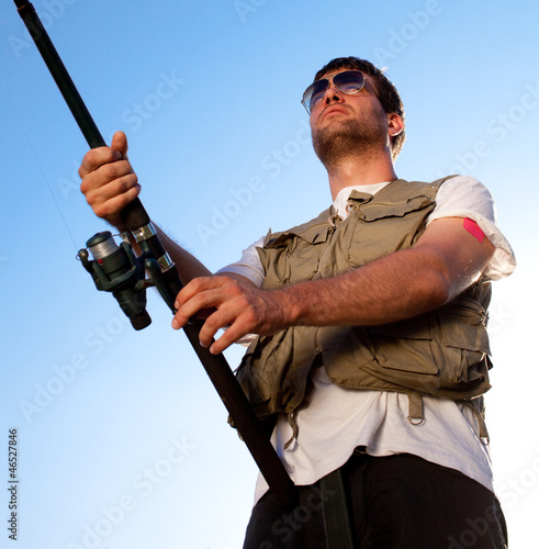Fisherman against blue sky