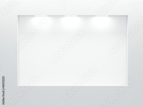 Empty illuminated  showcase on the white wall.