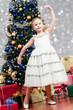 Merry Christmas - lovely girl enjoying Christmas