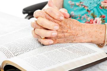 Praying Senior Hands on Bible