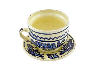 Handpainted cup and saucer isolated on white