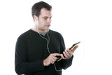 man with headphones, holding a tablet