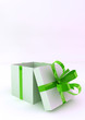 White gift boxes with green ribbons