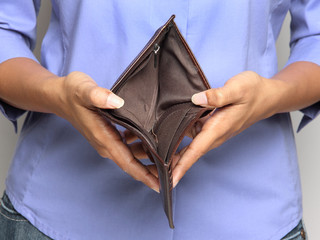 Person holding an empty wallet - showing bankruptcy