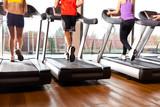 Fototapety Running on treadmills in a gym