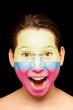 girl with ecuadorian flag on her face