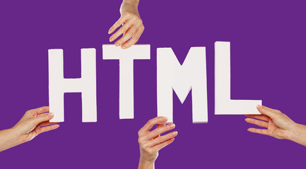 Female hands holding letters HTML