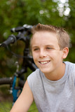 Sweaty teen boy smiling after biking for exercise