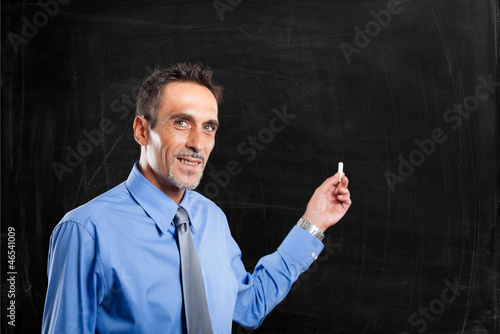 Man showing an empty blackboard