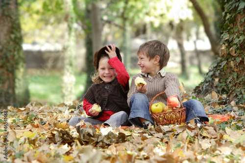 young happy children - boy and girl - on natural autumn backgrou
