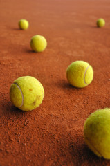 Six tennis balls on court